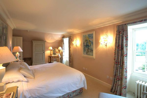 A colour image of a double bedroom with ensuite at Edradynate Country House and Sporting Estate Scotland,