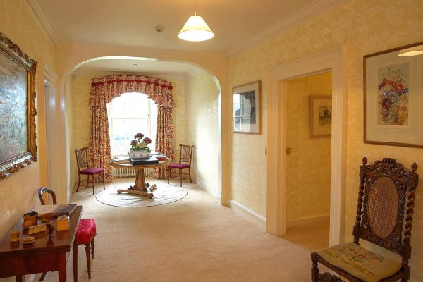 A colour image of the upstairs landing and hallway at Edradynate Country House and Sporting Estate Scotland. Edradynate is available for rent, shoot days, fishing and family holidays on a catered or self catered basis.