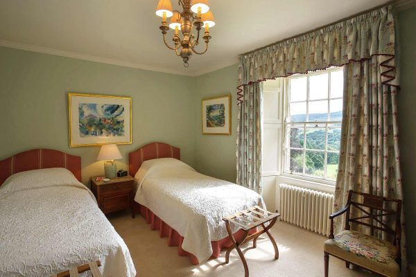 A colour image of a twin room with ensuite at Edradynate Country House and Sporting Estate Scotland. Edradynate is available for rent, shoot days, fishing and family holidays on a catered or self catered basis.