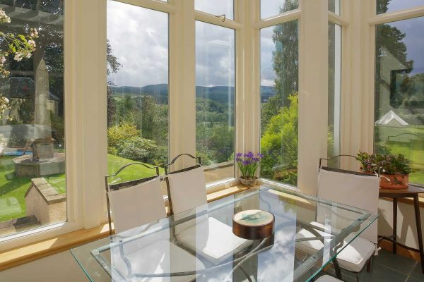 A colour photograph of the conservatory at EdradynateLuxury self catering accommodation in Scotland - Edradynate Country House and Sporting Estate House Perthshire
