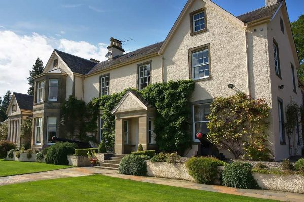 A colour photograph of the outside of Edradynate Country House External View - Luxury Scottish Country House for Rent & Sporting Estate in Perthshire, Scotland, available for rent, shoot days, fishing and family holidays on a catered or self catered basis.