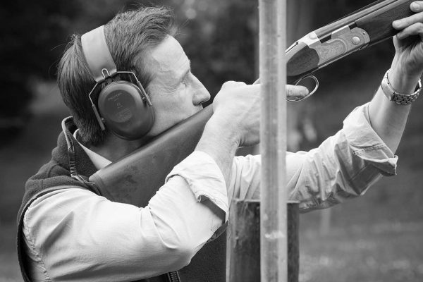 A black and white photo of a guest enjoying clay pigeon shooting at the Edradynate clay pigeon shoot day May 2017 - Edradynate Estate, Perthshire - Luxury Country House and Sporting Estate for Rent in Scotland