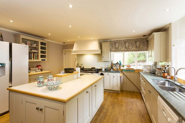 An image of the shaker style kitchen at Edradynate Country House and Sporting Estate Scotland. Edradynate is available for rent, shoot days, fishing and family holidays on a catered or self catered basis.