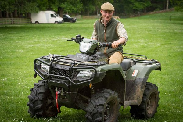 A colour image of Ciaran Woodman- Robinson Underkeeper riding a quad bike at the Edradynate May 2017 clay pigeon shoot day - Edradynate Estate, Perthshire - Luxury Country House and Sporting Estate for Rent in Scotland