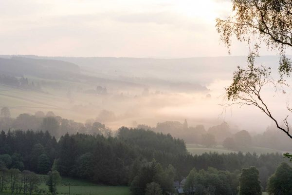 An image taken in the morning showing mist across the hills at Edradynate Estate, Perthshire - Luxury Country House and Sporting Estate for Rent in Scotland