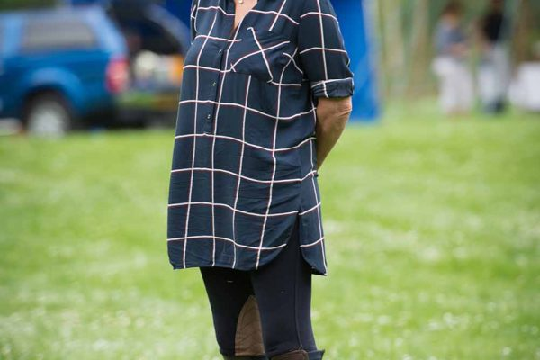 A colour image of a female guest in shoot apparel spectating at the Edradynate May 2017 clay pigeon shoot day - Edradynate Estate, Perthshire - Luxury Country House and Sporting Estate for Rent in Scotland