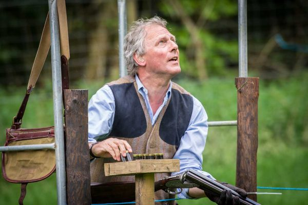 A colour image of a gentleman loading cartridges at the Edradynate May 2017 clay shooting day - Edradynate Estate, Perthshire - Luxury Country House and Sporting Estate for Rent in Scotland
