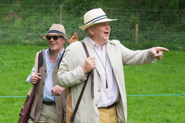 A colour image of gentlemen in panama hats laughing and enjoying clay pigeon shooting at the Edradynate May 2017 shoot day - Edradynate Estate, Perthshire - Luxury Country House and Sporting Estate for Rent in Scotland