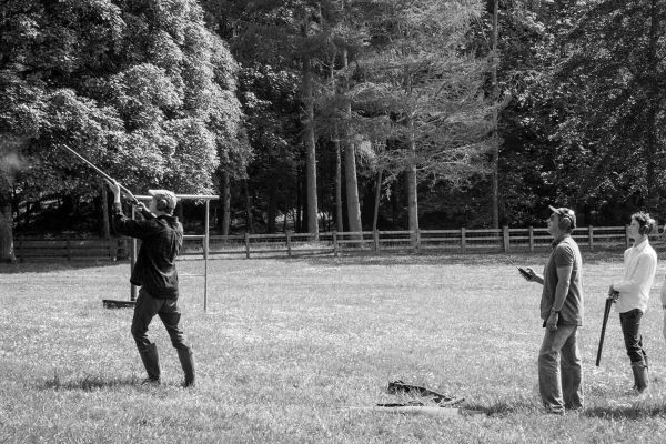 A black and white image of guests clay pigeon shooting at at the Edradynate May 2017 shoot day - Edradynate Estate, Perthshire - Luxury Country House and Sporting Estate for Rent in Scotland
