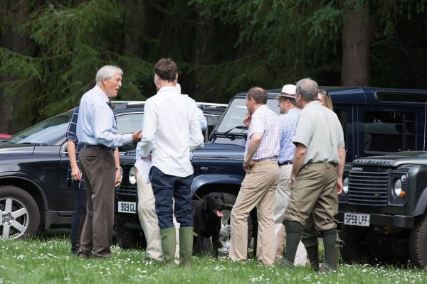 A colour image of guests socialising stood by 4 x 4 vehicles at the Edradynate May 2017 clay pigeon shoot day - Edradynate Estate, Perthshire - Luxury Country House and Sporting Estate for Rent in Scotland