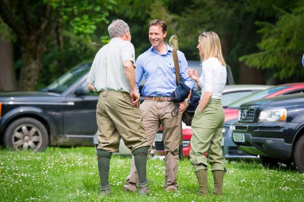 A colour image of guests socialising at the Edradynate May 2017 clay pigeon shoot day - Edradynate Estate, Perthshire - Luxury Country House and Sporting Estate for Rent in Scotland