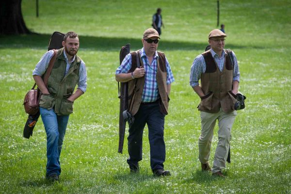 A colour image of guests walking and carrying guns at the Edradynate May 2017 clay pigeon shoot day - Edradynate Estate, Perthshire - Luxury Country House and Sporting Estate for Rent in Scotland