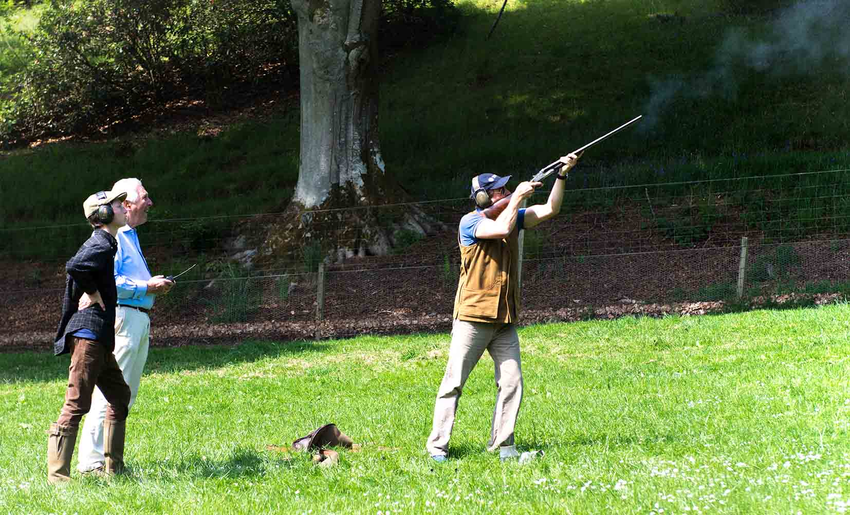 A colour image of Michael Campbell spectating clay pigeon shooting at the Edradynate shoot day in May 2017 -Edradynate Estate, Perthshire - Luxury Country House and Sporting Estate for Rent in Scotland
