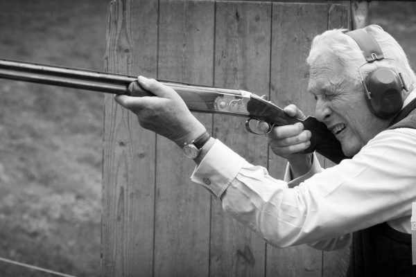 A black and white image of Michael Campbell clay pigeon shooting at the Edradynate shoot day in May 2017 -Edradynate Estate, Perthshire - Luxury Country House and Sporting Estate for Rent in Scotland