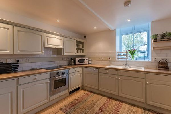 A colour image of the kitchen at Aodin - accommodation for a a self catering holiday Scotland - Edradynate Country House and Sporting Estate Perthshire