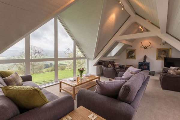 A colour image of the living areas with spectacular views at Aodin - accommodation for a a self catering holiday Scotland - Edradynate Country House and Sporting Estate Perthshire