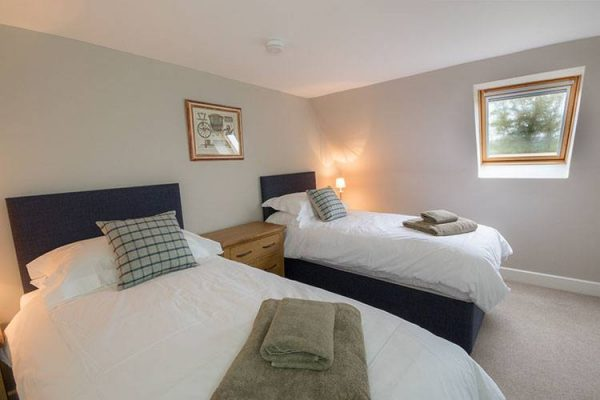 A colour image of a twin bedroom at Aodin accommodation for a a self catering holiday Scotland Edradynate Country House and Sporting Estate Perthshire