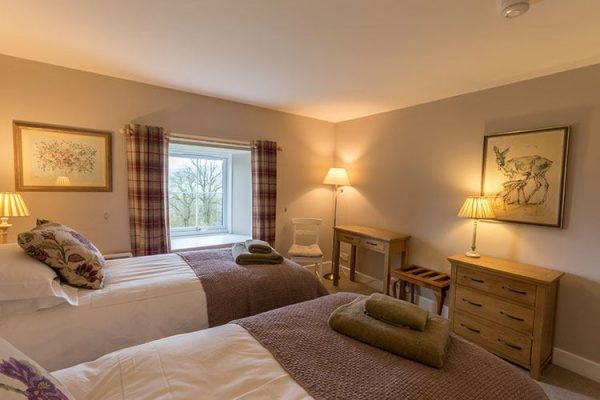 A colour image of a twin bedroom at Aodin - accommodation for a a self catering holiday Scotland - Edradynate Country House and Sporting Estate Perthshire