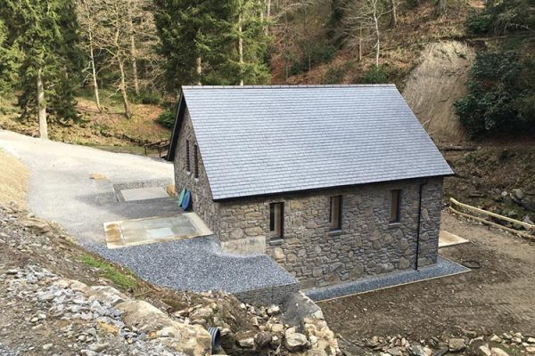 A colour image of the turbine house of the Beinn Eagagach Hydro Scheme at Edradynate Estate Perthshire
