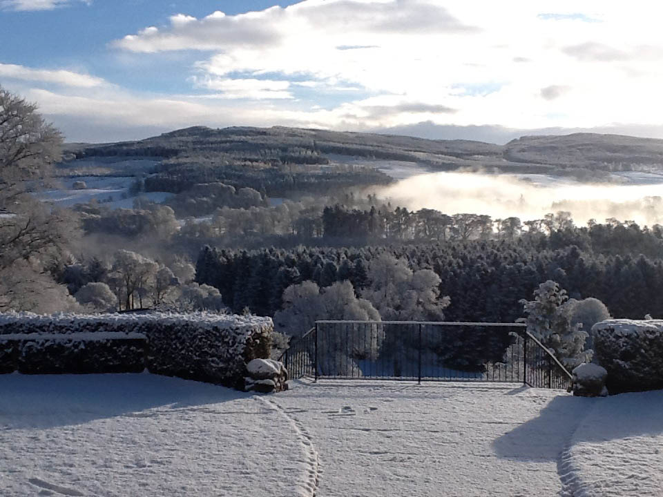 A colour image showing Edradynate Estate Perthshire in the snow